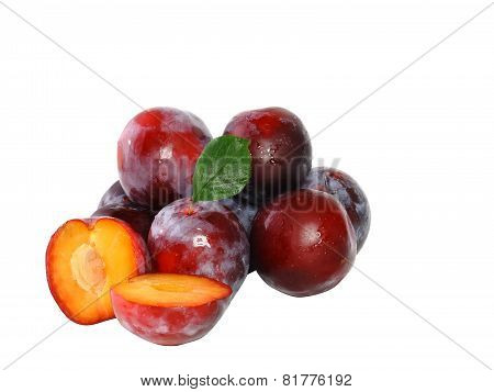 Heap Of Plums With Green Leaf. Isolated.