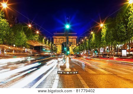 Evening On Champs-elysees In Front Of Arc De Triomphe.paris. France.
