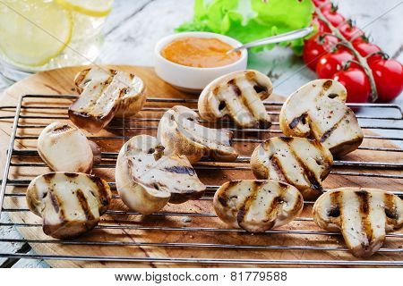 Grilled mushrooms with sauce on the grill vegetables