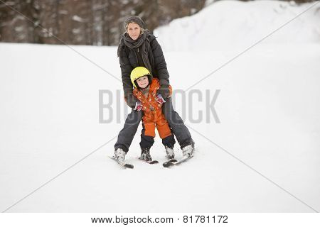 Mother and child learn to ski together