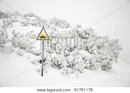 Snow mobile warning sign in winter time