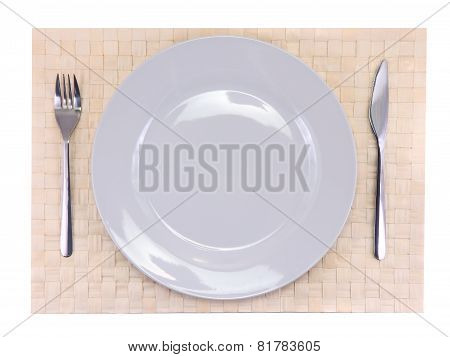 Table Serving-knife,plate,fork On Colour Backdrop.