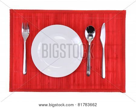 Table Serving-dishware On Red Backdrop.