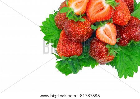 A Heap Of Strawberries On Green Foliage. Isolated