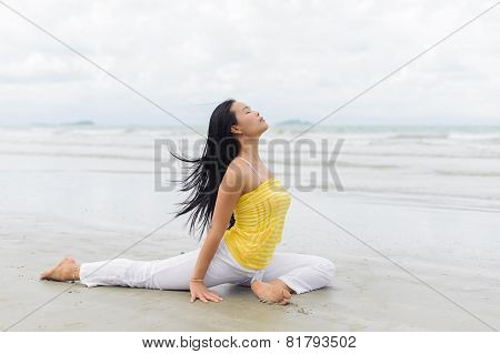 Beautiful Woman Yoga On The Beach.