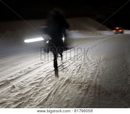Woman Walking On Winter Road