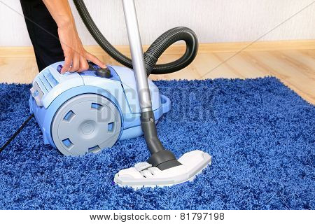 Vacuum cleaner in action.
