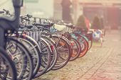 stock photo of pedal  - Group of bikes in parking in Amsterdam - JPG