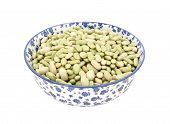 pic of phaseolus  - Flageolet beans in a blue and white porcelain bowl with a floral design isolated on a white background - JPG