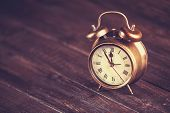 foto of analog clock  - Retro alarm clock on a table - JPG