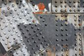 picture of girder  - Industrial steel girder background with rivets rust and weathered paint - JPG