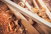 stock photo of carpenter  - Wooden planks and shavings at carpenters workshop - JPG