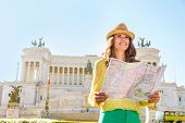 image of piazza  - Happy young woman with map on piazza venezia in rome italy - JPG