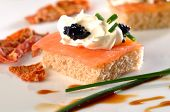 pic of canapes  - Salmon and caviar canape on plate with decoration - JPG