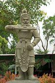 stock photo of lantau island  - stone statue of ancient chinese warrior - JPG