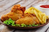 stock photo of fried chicken  - fried chicken wings in batter with french fries - JPG