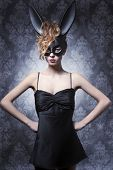 stock photo of bunny costume  - Sexy lovely charming elegant woman in black bunny carnival costume curly hairstyle and nice make up - JPG