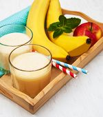 picture of fruit shake  - Banana smoothie and fruits on a wooden background - JPG