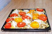 picture of flabby  - Raw chiken on baking tray with tomato and potato - JPG
