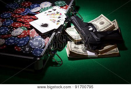 Poker chips and gun
