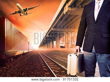 Business Man With Metal Breifcase Investment  Standing Against Airpalne ,trains And Ship Port  Trans