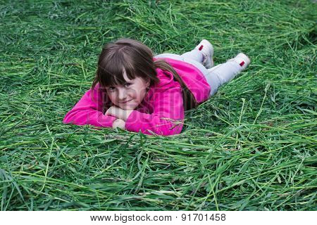 Cheerful Girl On The Grass