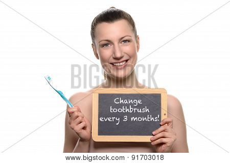 Bare Woman Holding Toothbrush And Empty Board