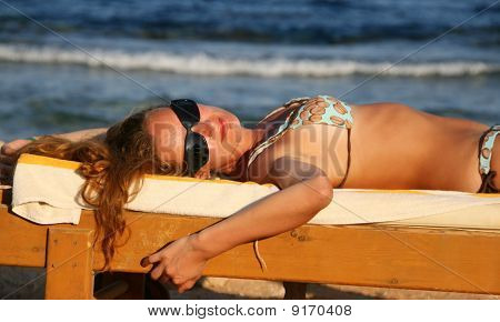 Woman In Glasses On Chaiselongue