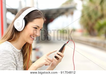 Teen Girl Listening To The Music With Headphones Waiting A Train