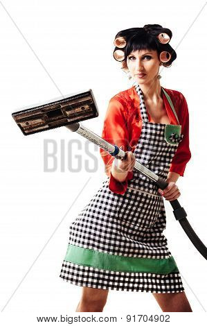 portrait of sexy female housewife cleaning with vacuum cleaner isolated on white background