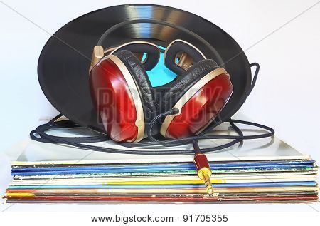 Headphones resting on a stack of vinyl