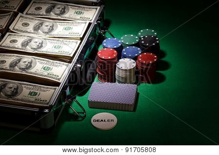 Poker chips and dollar bills in case