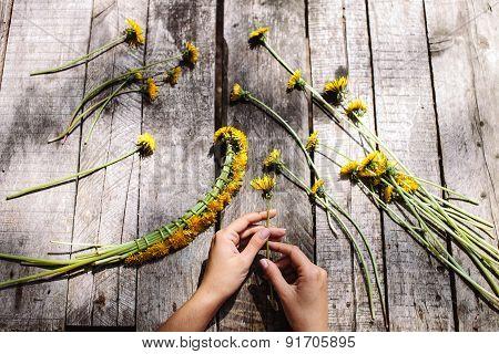 Wreath Of Dandelions Flowers Handmade On Wood Table