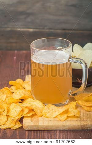 Beer With Foam In Glass Mug And Potato Chips