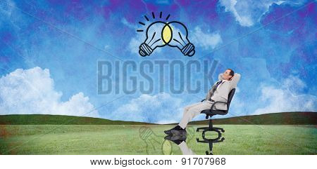 Businessman relaxing in swivel chair against painted country scene