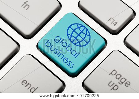 blue global business icon on computer key