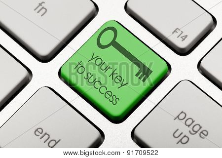 Green key on computer keyboard Key to success concept