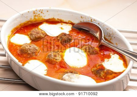 baked Bolognese balls with tomato, basil and fresh bull mozzarella