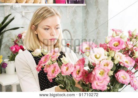 Pretty Girl Is Choosing Flowers For Herself