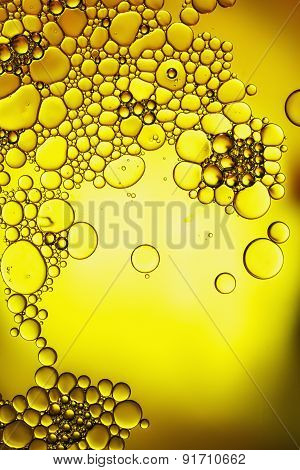 Oil Floating On Yellow Background
