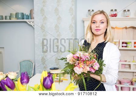Young And Cute Woman Looks Content With Her Work