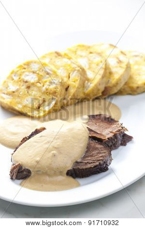 sirloin on cream with dumplings