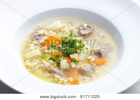 Scottish soup of mutton meat with kohlrabi and barley
