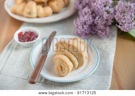 Fresh baked croissants with strawberry marmalade for breakfast