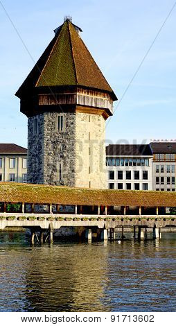 Close Up Tower And Wooden Chapel Bridge In Lucerne
