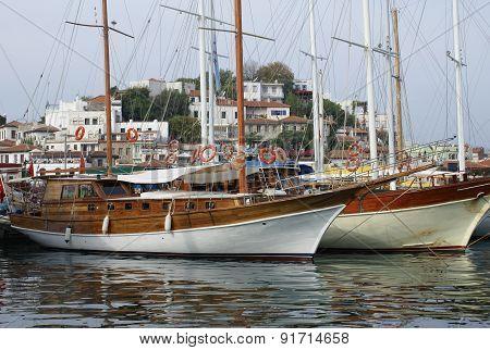 Sailing boats at pier