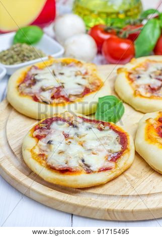 Mini Pizza With Salami, Bacon, Mushrooms And Cheese