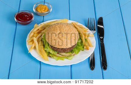 Burger, french fries and sauses