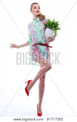 Beautiful sexual blonde in varicoloured clothes with the basket of flowers isolated on a white background