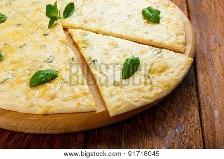 Delicious Four Cheese Pizza With Basil Leaves